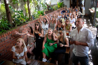 Patrons at the Prince Alfred Hotel in Richmond, including Glen Perry and Molly Tobin, at front, cheer on the horses on Tuesday.