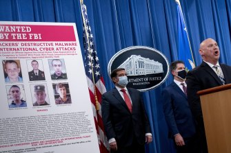 A poster showing six wanted Russian military intelligence officers is displayed in Washington in October.