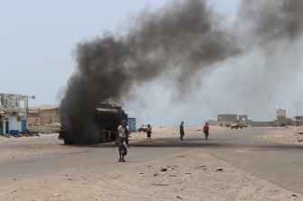 An oil tanker truck burns following recent clashes between Yemeni southern separatists and government forces near Aden, Yemen.