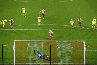 Billy Sharp scores just the ninth goal of Sheffield United's Premier League season.
