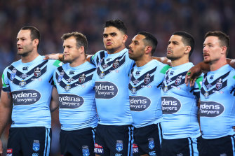 Mitchell among his NSW teammates at the singing of the anthem during Origin last year.
