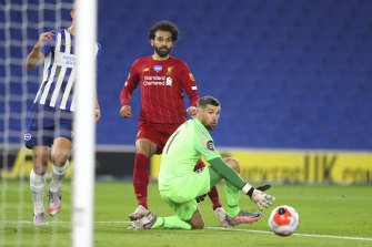 Brighton's Mathew Ryan watches as a shot from Liverpool's Mohamed Salah goes wide last season.