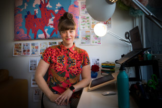 Sarah Firth is a graphic recorder, pictured here in her home studio.