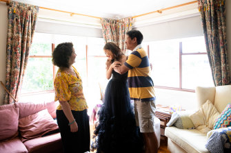 Daphne Fong with her parents, Selin and Martin Fong, as she prepares to leave for her school formal after months of uncertainty.