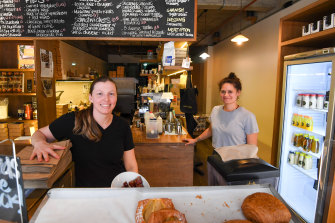 Bourke Street Bakery staff Kimberley Reed and manager Trina Bryan wait for lunch time customers in North Sydney.