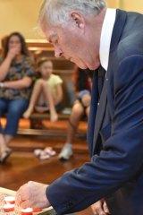 WA Governor Kim Beazley joins Muslim and Christian community members at the vigil.