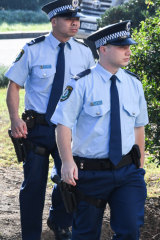 Senior Constable Frederick Tse, left, and Senior Constable Jakob Harrison, right, arrive at the NSW Coroners Court on Friday.