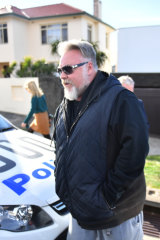Kyle Sandilands arrives at John Ibrahim's house during a police operation on Tuesday.