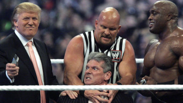 """McMahon, centre, being held by """"Stone Cold"""" Steve Austin and Donald Trump at Wrestlemania 23."""