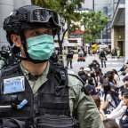 Riot police round up a group of protesters during a demonstration on Wednesday May 27.