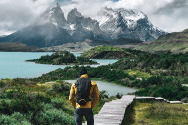 man hiking at torres del paine - chile satmar28cover