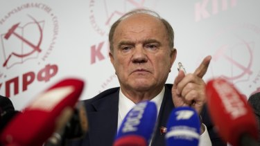 Russian Communist Party leader Gennady Zyuganov gestures at his news conference on Sunday.