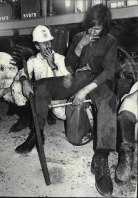 Exhausted, firefighter John Gill takes a break. October 4, 1971.