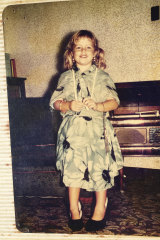 Mitchell as a young girl dressing up.