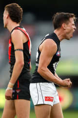 Matt Owies celebrates one of his three majors against the Bombers.