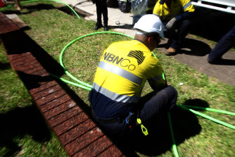 """Labor said NBN technicians did back-breaking dirty work while """"executives wallow in $77 million in bonuses""""."""