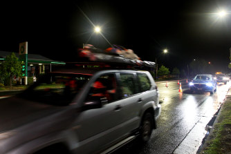 Cars cross the NSW-Victoria border after it reopened overnight.