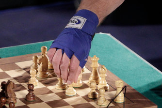 A player makes his move during a bout of chessboxing.