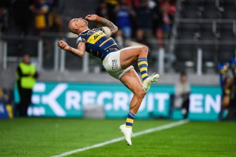 Flipping out: Blake Ferguson performs a back flip after scoring a spectacular try.