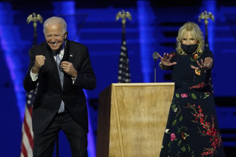 President-elect Joe Biden and wife Jill Biden gesture to supporters after claiming victory.