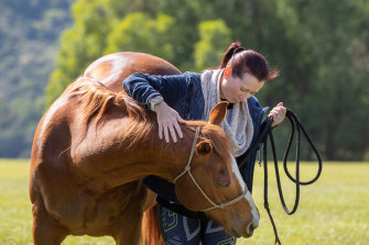 Annette Demosthenous with Jack, an equine therapy horse at Gwinganna Lifestyle Retreat in Tallebudgera Valley.