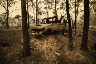 A National Parks and Wildlife Service LandCruiser lies burnt at Tallowa Dam Road in Kangaroo Valley.
