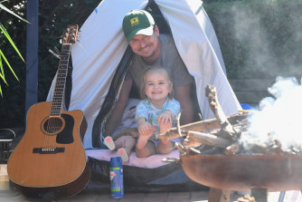 Martin Turner with his 3-year-old daughter camping in their backyard in the Sutherland Shire.