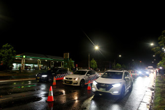 Cars make their way along Wodonga Place as the border checkpoint at South Albury is reopened.