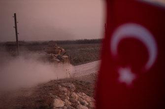 A Turkish armoured vehicle speeds towards the Syrian border near Akcakale.