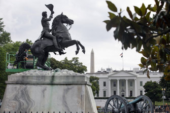 A worker cleans a statue of former US president Andrew Jackson near the White House last week. Protesters failed to bring it down on Monday.