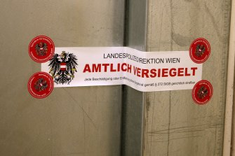 """The seal with the inscription """"State police department of Vienna, officially sealed"""" marks the door of a terror suspect's apartment."""