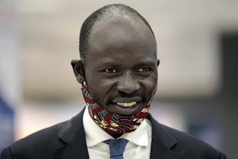 Peter Biar Ajak smiles before giving an interview upon his arrival at Washington Dulles International Airport in Chantilly, Virginia.