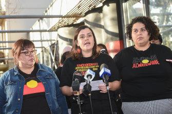 Meriki Onus (centre) from the Warriors of Aboriginal Resistance speaks on Friday.