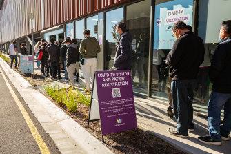 People queue for COVID vaccines in regional Victoria.