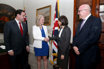 Jobs Minister Stuart Ayres, NSW Premier Gladys Berejiklian, and UK Trade Secretary Liz Truss meet at a welcome reception at Stoke Lodge hosted by Australia's High Commissioner to the UK, George Brandis.