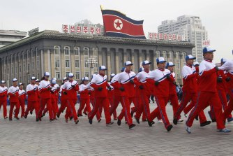 "Government officials take part in the first official ""sports day"" of the new year at Kim Il-sung Square in Pyongyang."