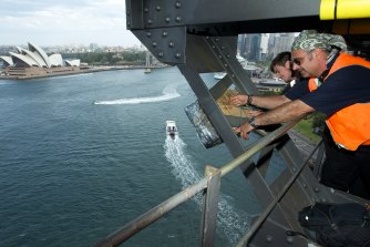 Fortunato Foti watches as fireworks are installed on the lower gantry of the Sydney Harbour Bridge on December 28, 2012.