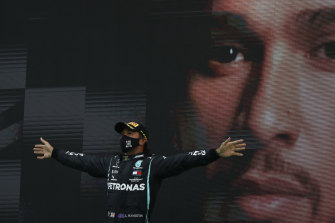 Mercedes driver Lewis Hamilton celebrates after winning the Portuguese Grand Prix at the Algarve International Circuit in Portimao on Sunday.
