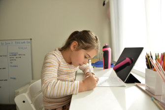 Five-year old Evie Macheda starts remote learning at home.