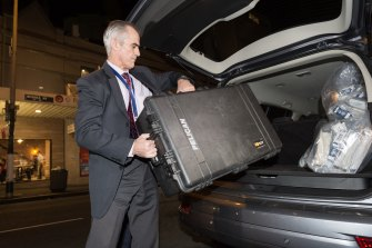 An AFP officer removes shredded documents and other evidence from the AWU offices in Sydney in 2017.