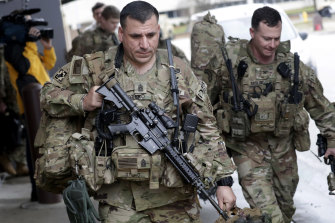 US soldiers prepare to board a bus at Fort Bragg military base.