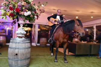 Matt Handbury arrives in style and serenades guests at his 70th birthday celebrations last Saturday night at the Murdoch family estate Cruden Farm in Melbourne.