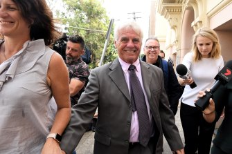 Former Reverend Ron Brookman (centre) leaves Newtown Court on Tuesday morning with his wife Ruth Brookman (left).