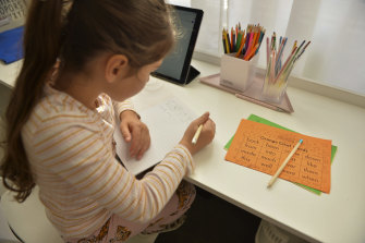 Evie Macheda, 5, starts remote learning at home on the first day of term two.