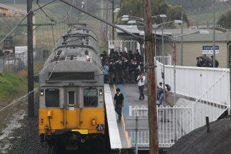 James Ruse Agricultural High School  students board the train at Carlingford Station, on Tuesday August 10, 2010.