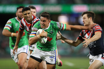 Joseph Tapine brushes Luke Keary aside on his way to the try line.