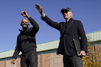 Former US President Barack Obama and then Democratic presidential nominee Joe Biden speak at a rally in Flint, Michigan.
