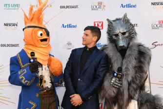 Host Osher Gunsberg with Masked Singer characters at the Logies in June.
