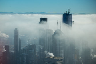 Melbourne's Eureka Tower poking through the clouds.