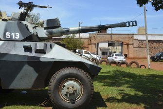 An armoured vehicle stands guard at Pedro Juan Caballero city jail in Paraguay following the jailbreak.